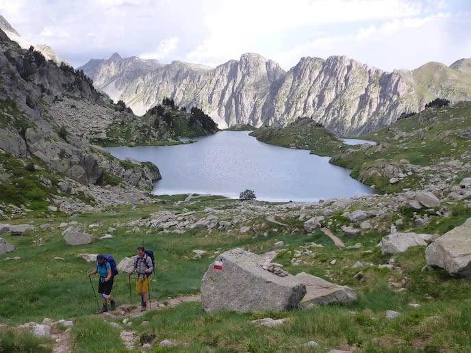 hikers trek the pyrenees mountains - call to adventure