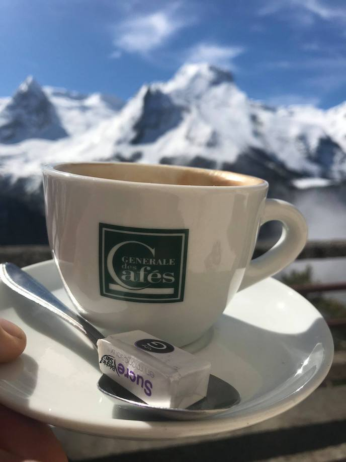 drinking coffee on the tour de france cycling pyrenees france - call to adventure