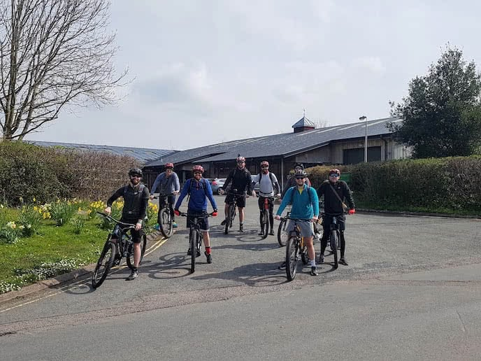 group of mountain bikers on biking holiday