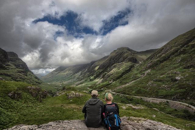 couple hiking holiday scotland mountains