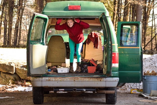 Lady smiling living in vehicle
