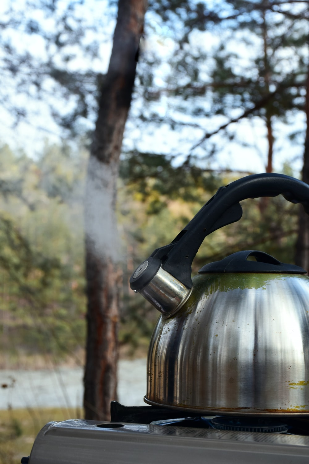 Boiling water in camping kettle