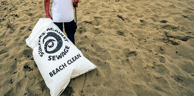 beach cleaning surfers against sewage