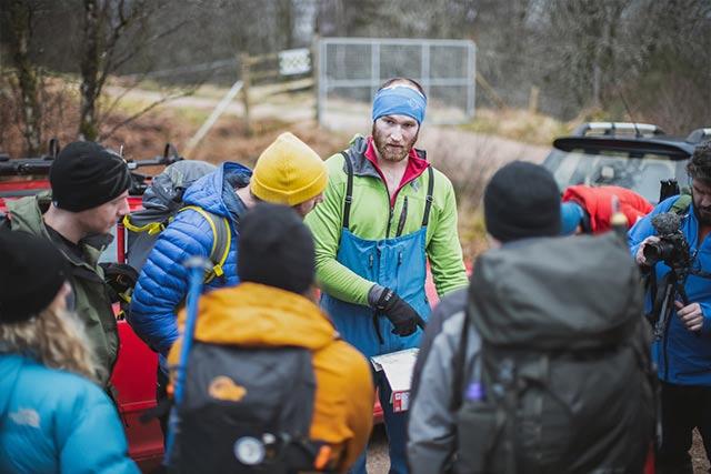 hikers read map before climbing ben nevis