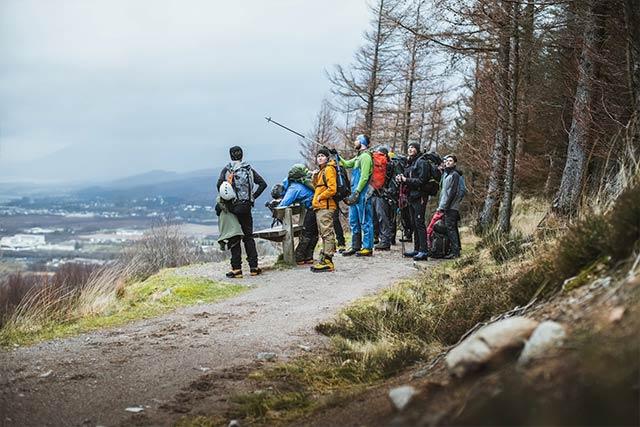 Mountain guide shows direction Ben Nevis