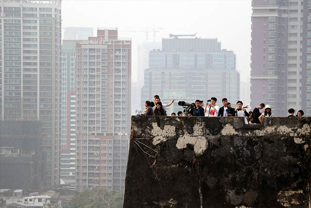 Group of people in polluted city