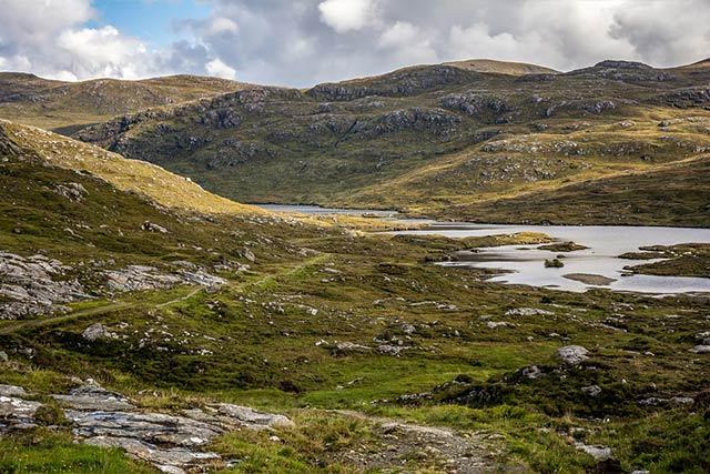Scottish hills with lake in midge season around the country