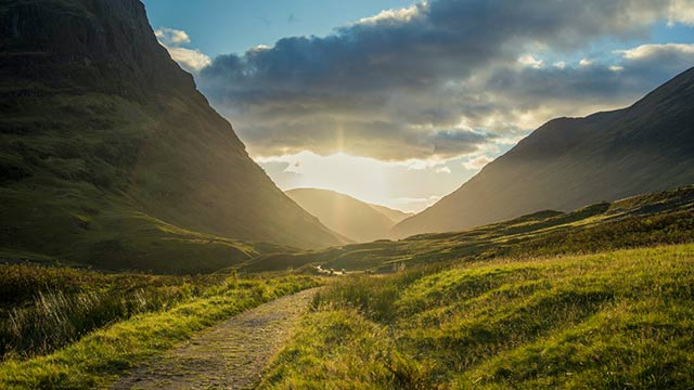 sun rise over mountains on West Highland Way