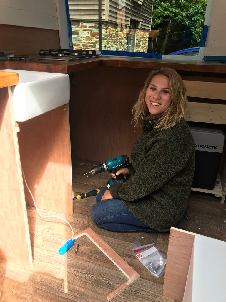 Fitting solar panels and solar batteries campervan