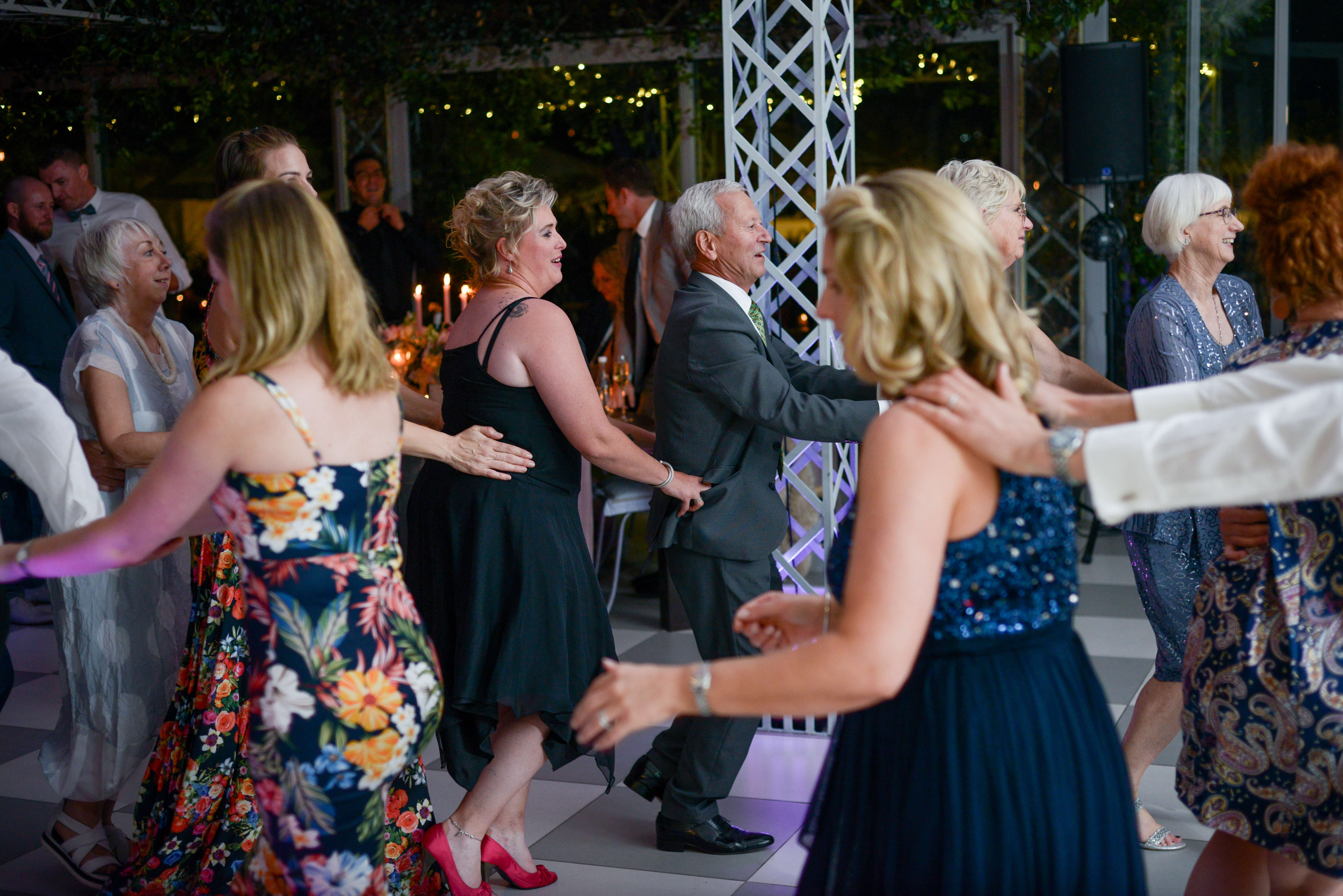 A massive crowd doing the locomotion at a beautiful Belair wedding.