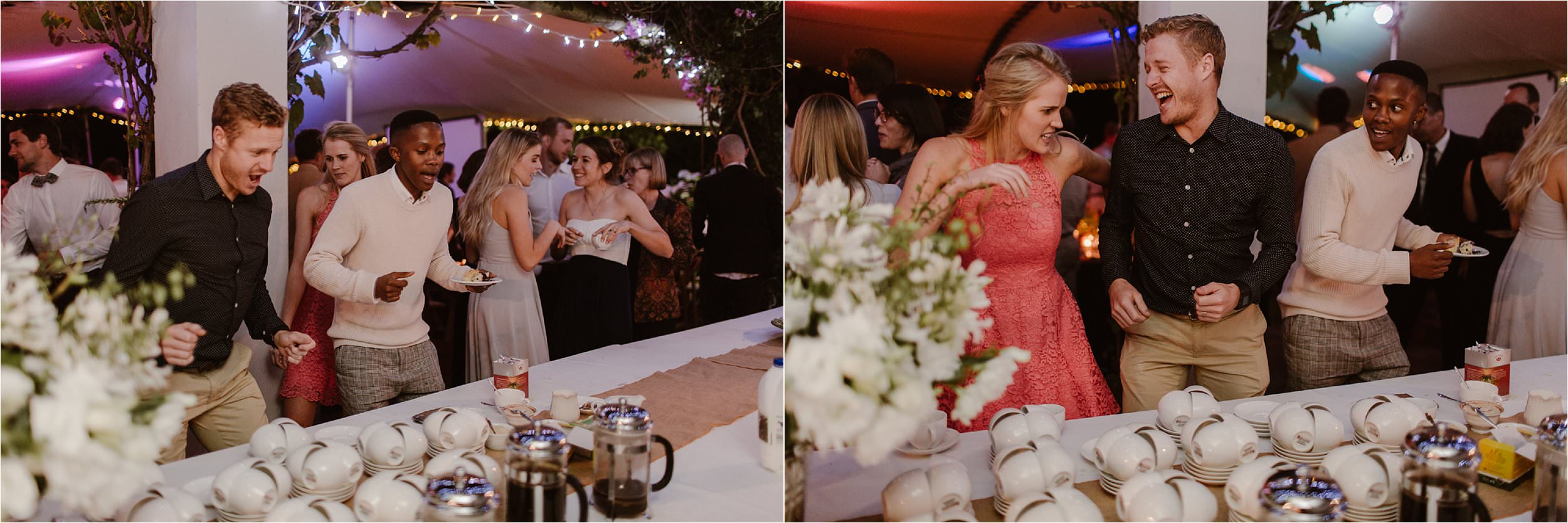 People dancing at the food table at a wedding because the music is so good.