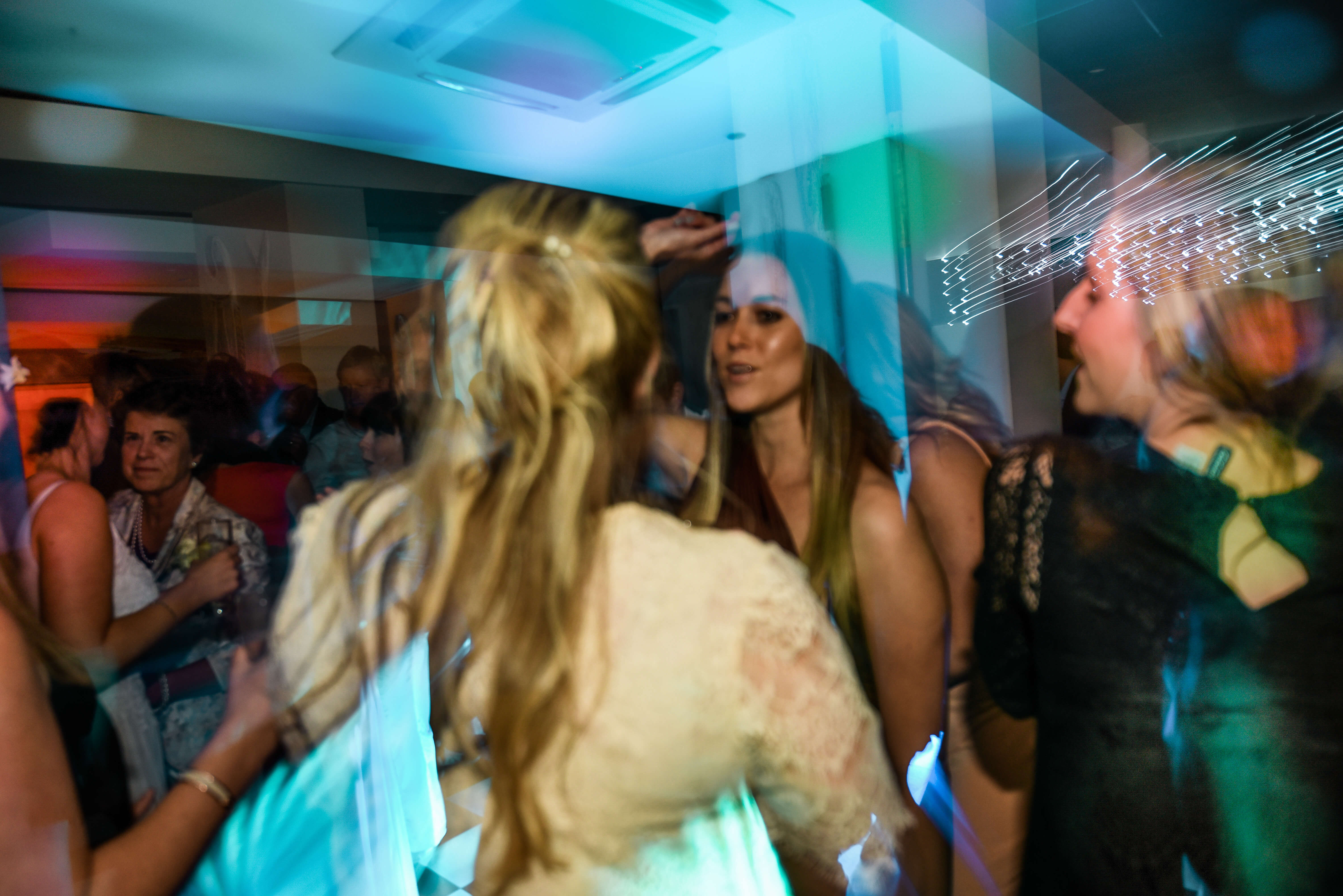Two beautiful ladies dancing at a wedding to the best DJ.