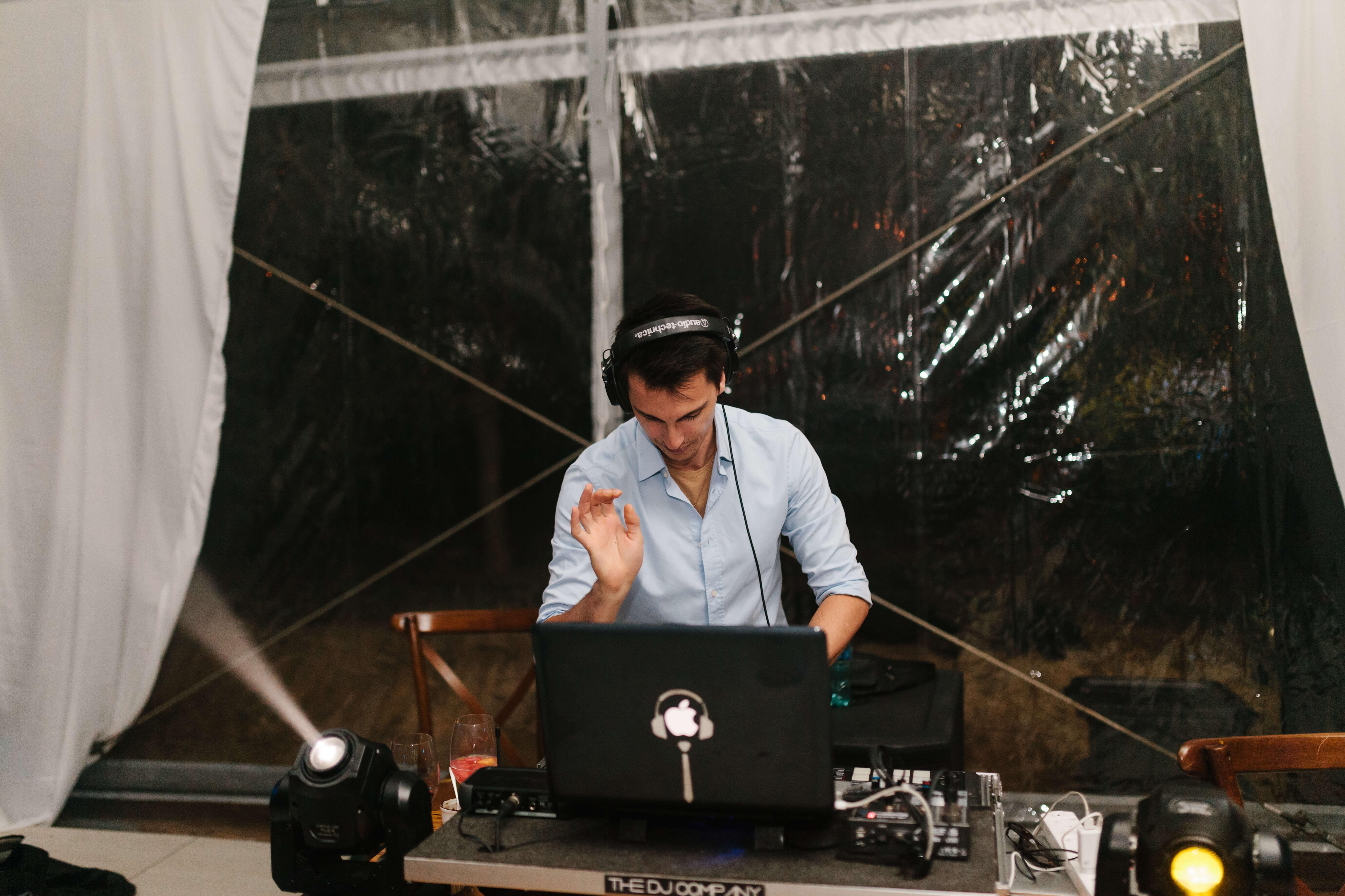 a Cape Town wedding DJ with a controller and laptop playing a set at an outdoor Stellenbosch wedding.