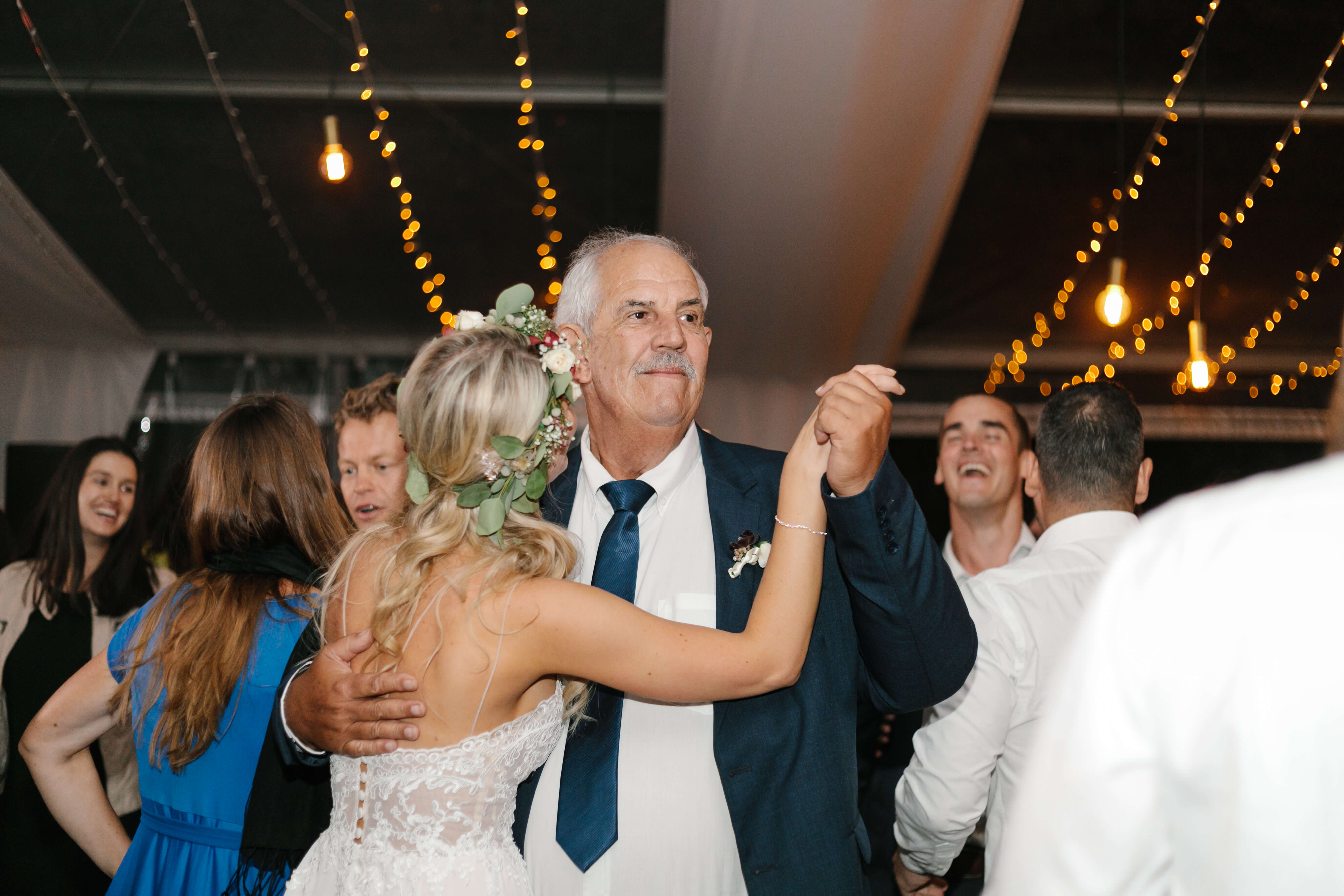 A proud father and his daughter dancing at her wedding.