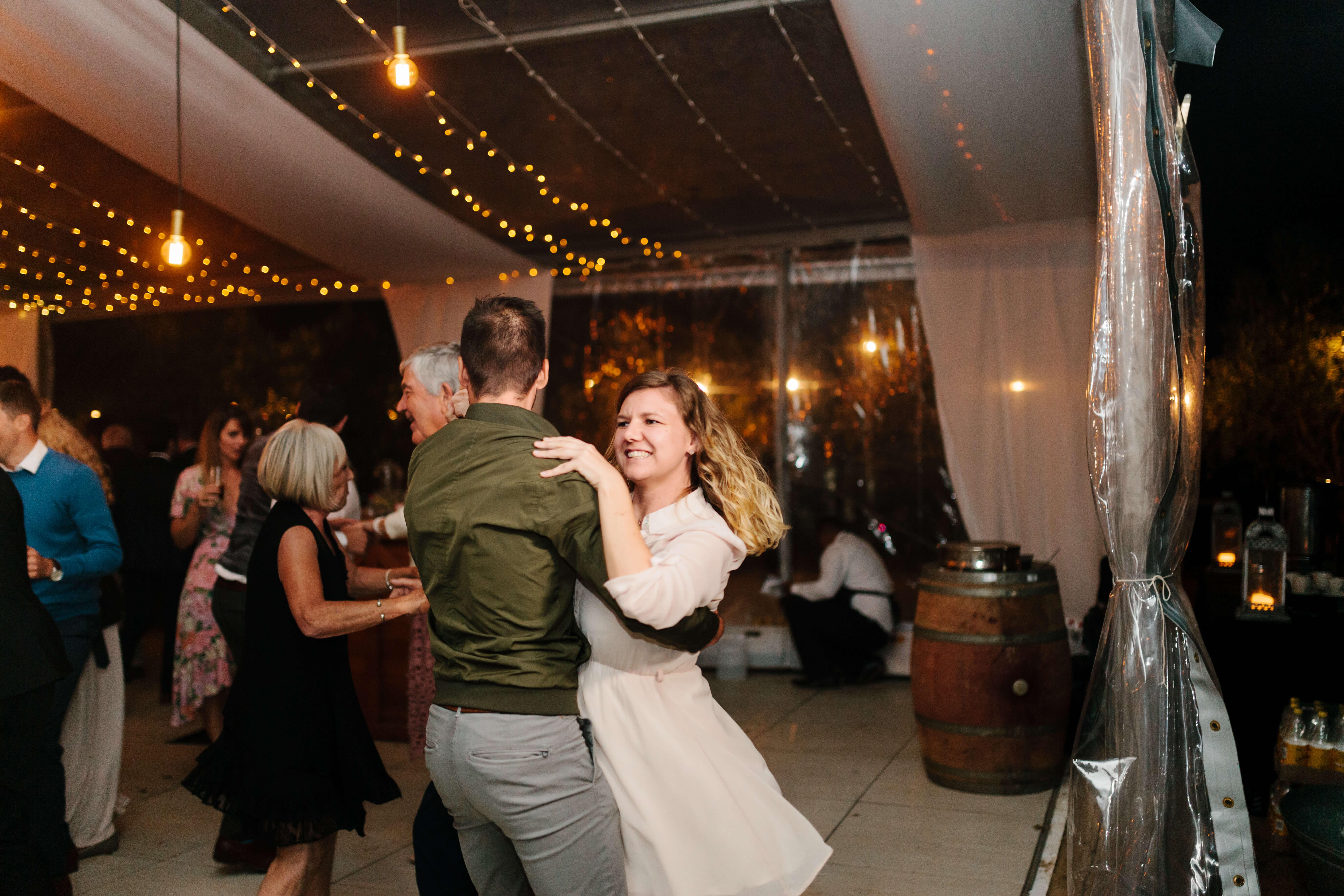 A short man and woman dancing on a Stellenbosch wedding dance floor.