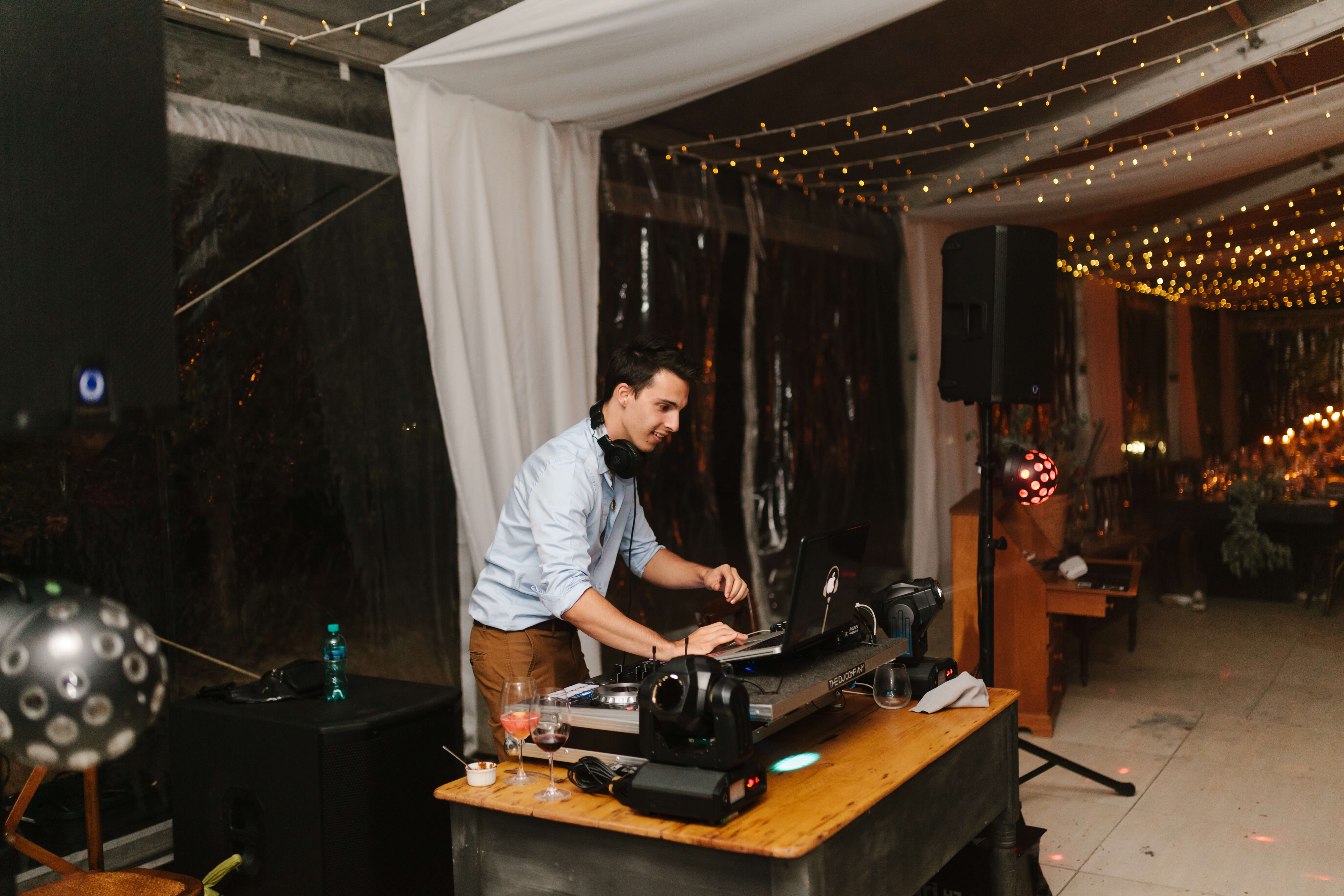 A wedding DJ performing at a wedding in Stellenbosch with lighting and sound.