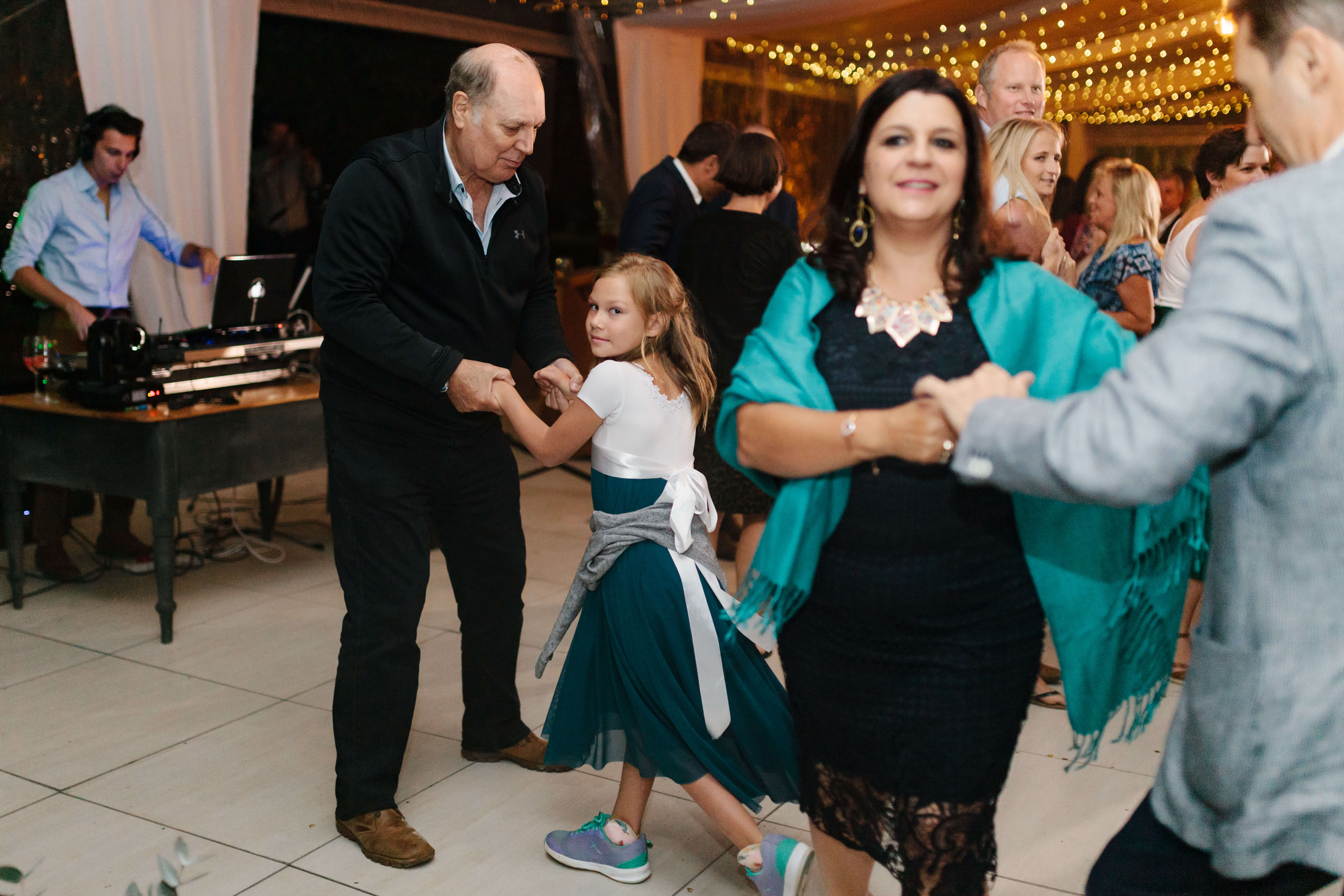 A young girl dancing with her grandfather to the best wedding DJ.