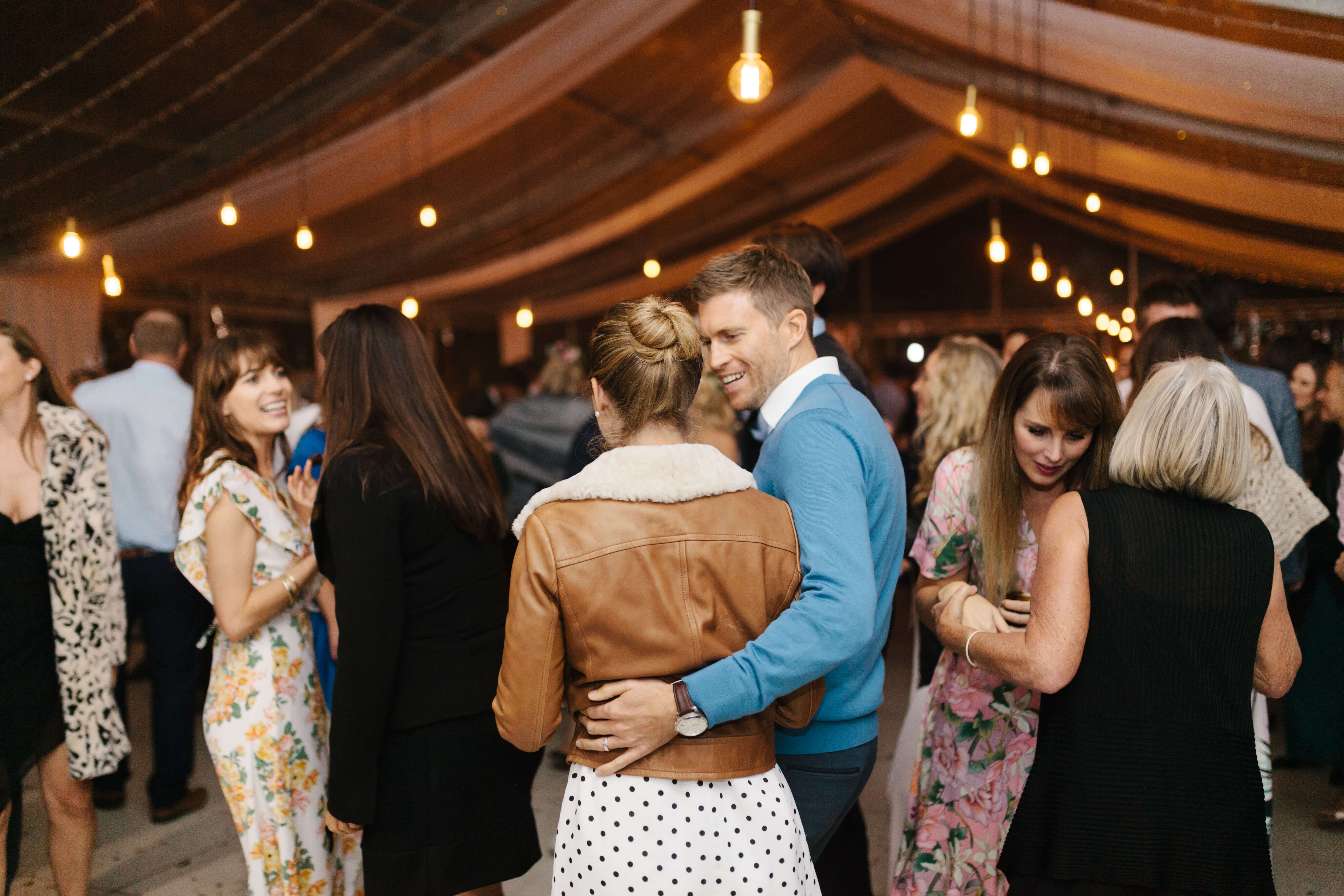 A couple embracing on a wedding dance floor.