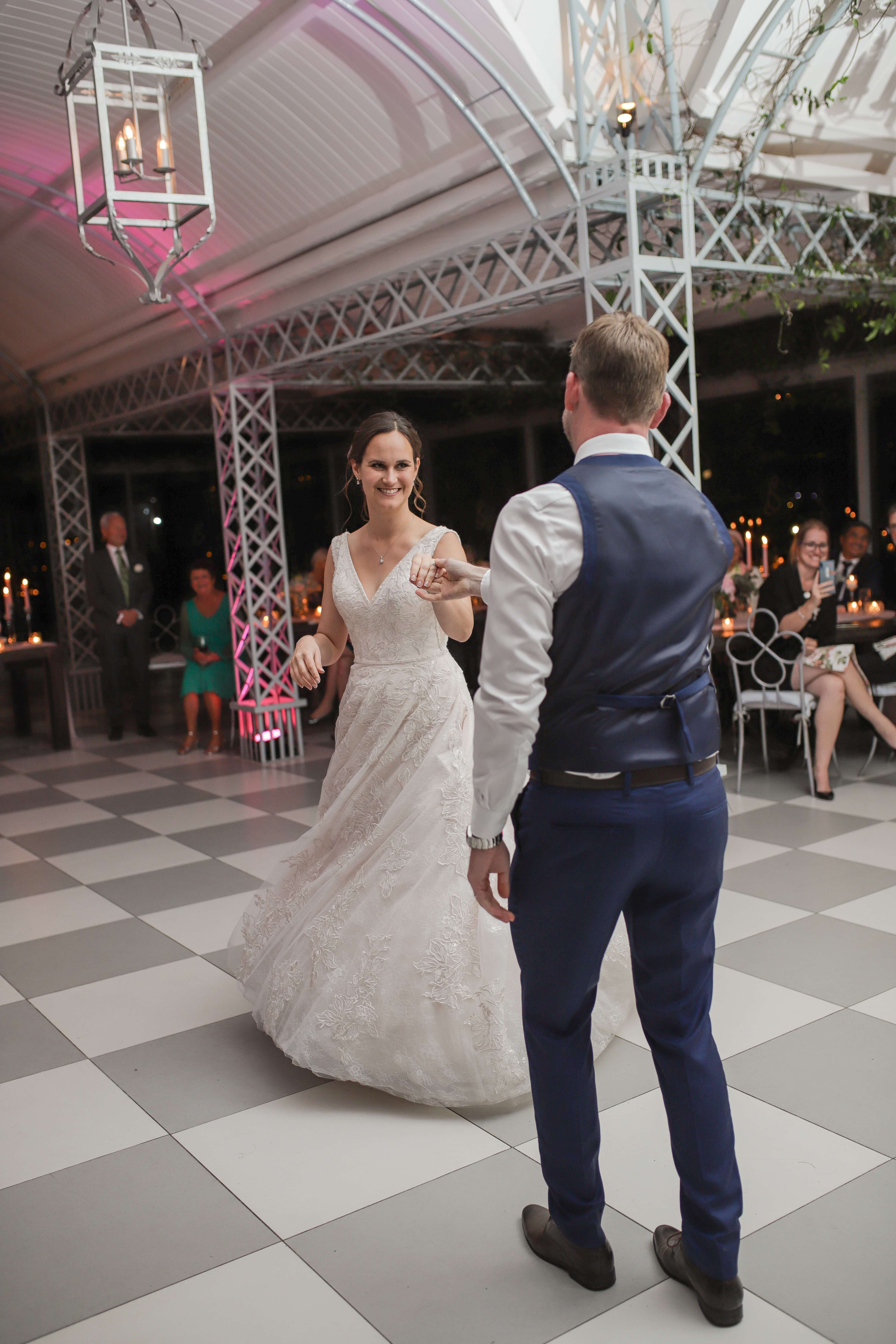 Newly wed couple dancing their first dance to an amazing song.
