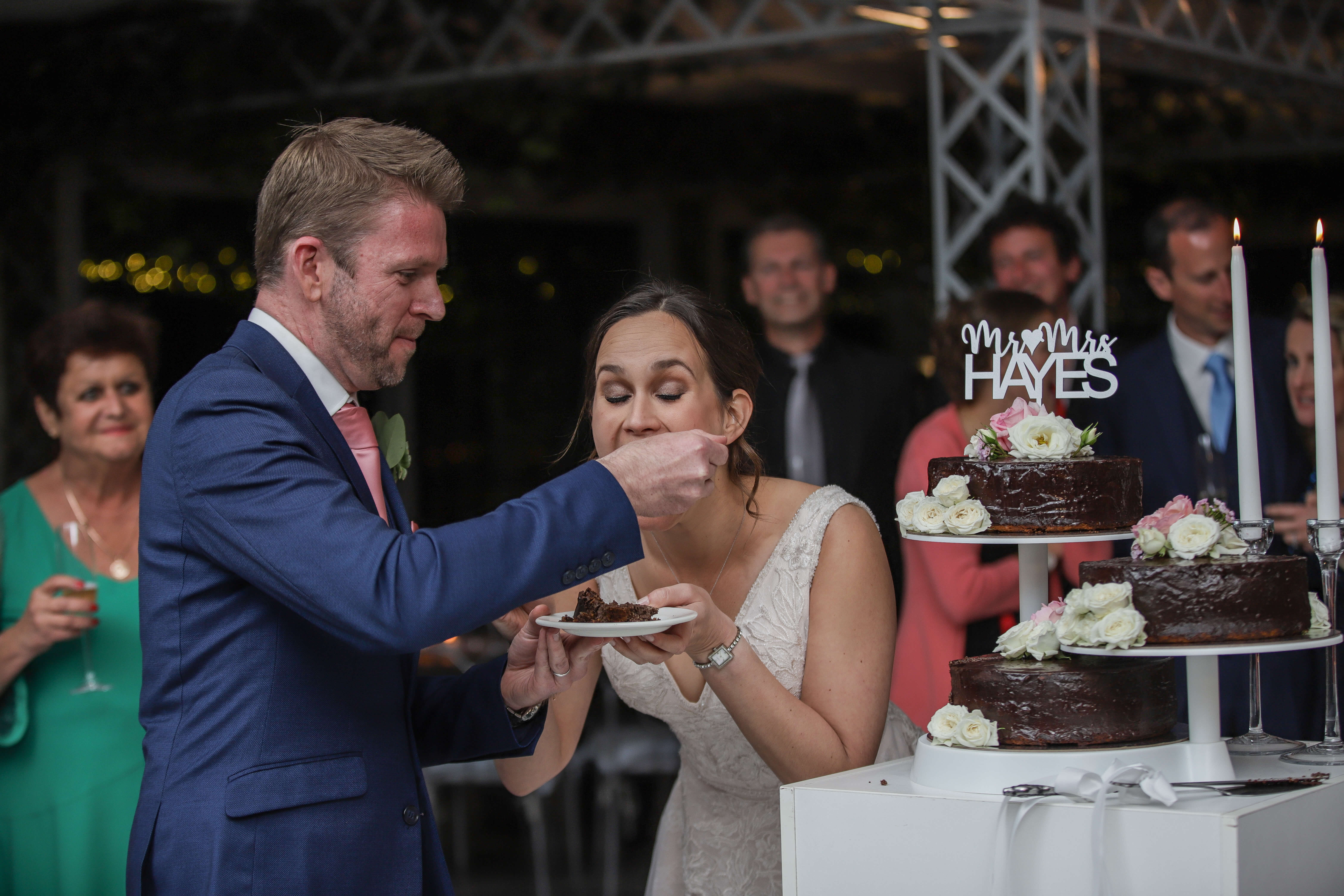 Bride and groom eating their wedding cake with a great song playing.