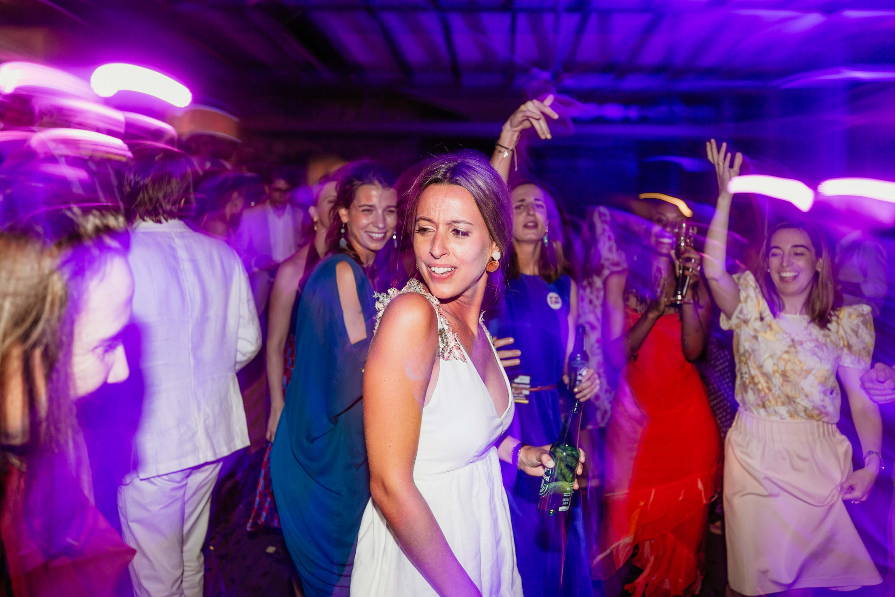 Bride dancing the night away as DJ plays her favourite song.