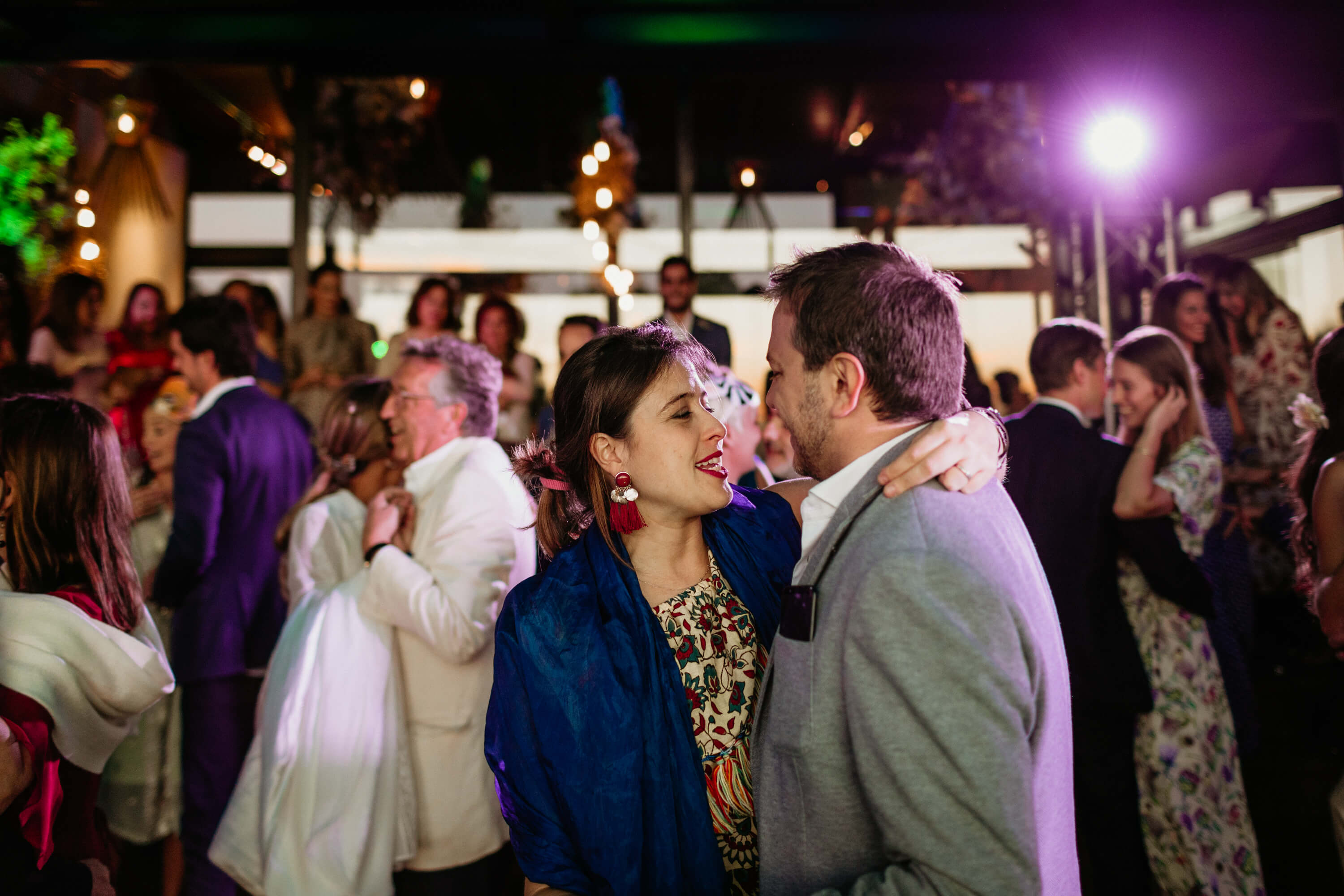 Loving couple staring into one anothers eye as they dance in celebration.