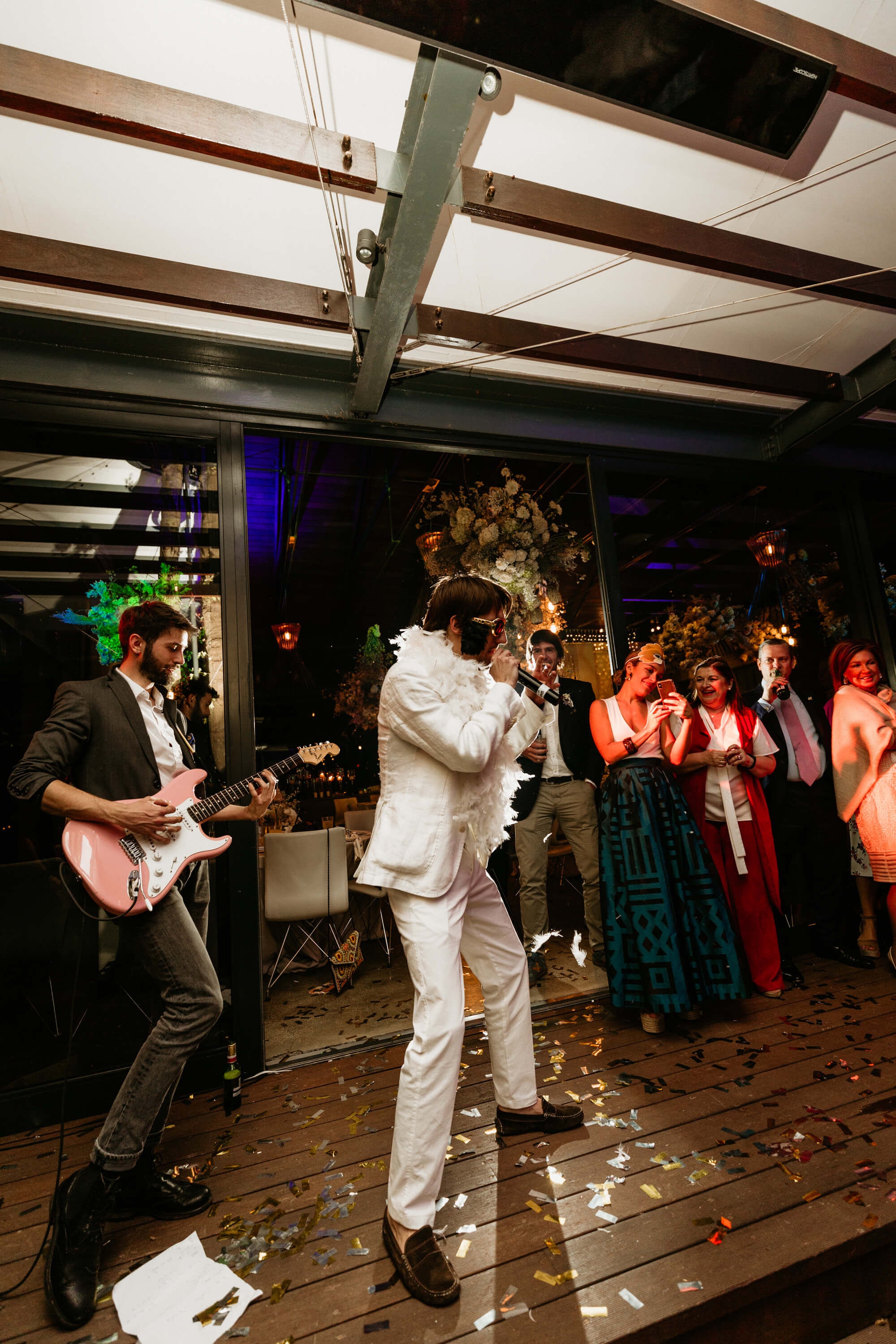 Elvis impersonator and live electric guitarist rocking the stage.