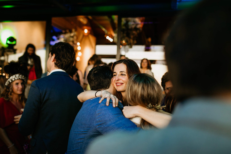 Group hug of loved amidst the dancefloor and dancing.