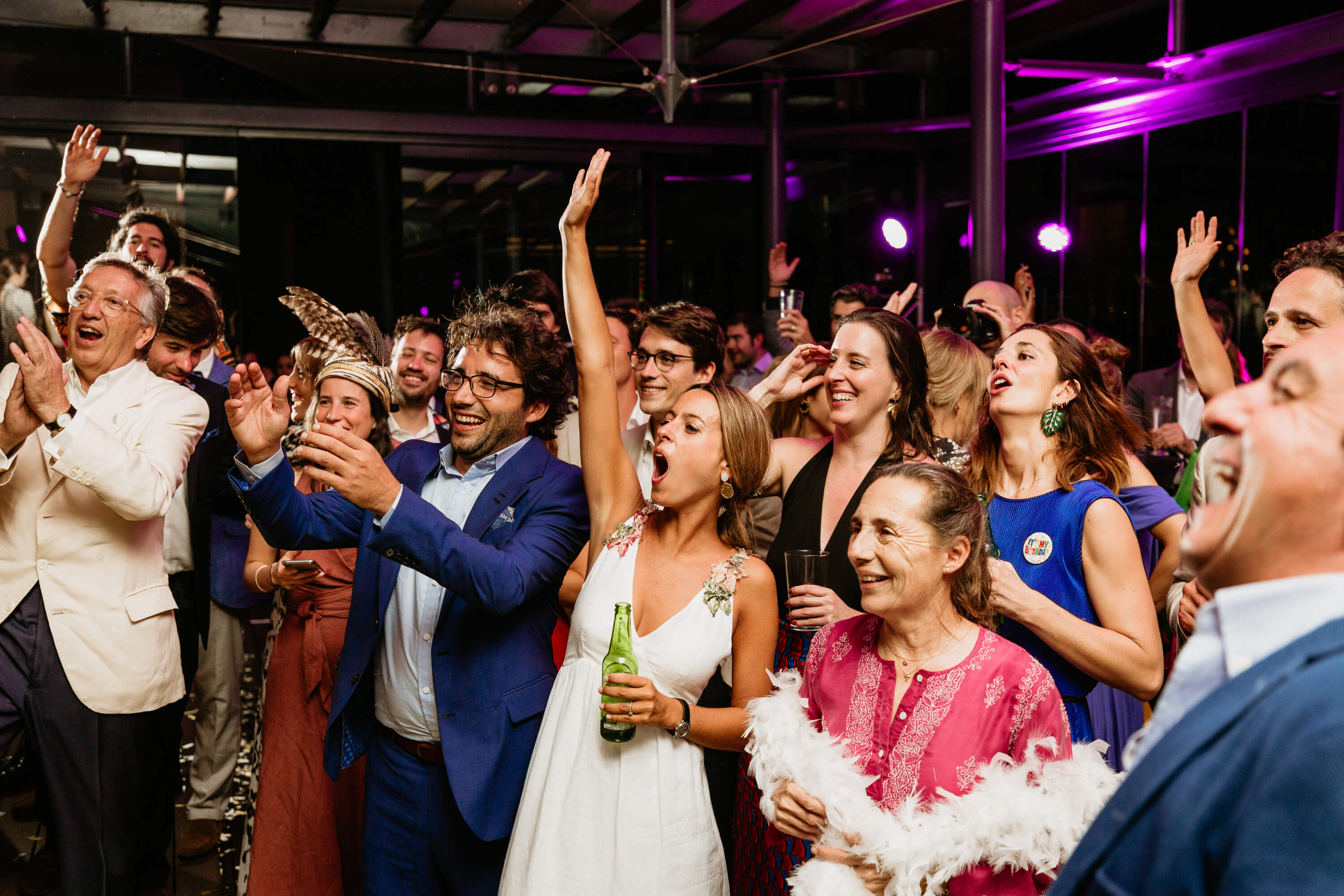 jubilant wedding party letting loose.