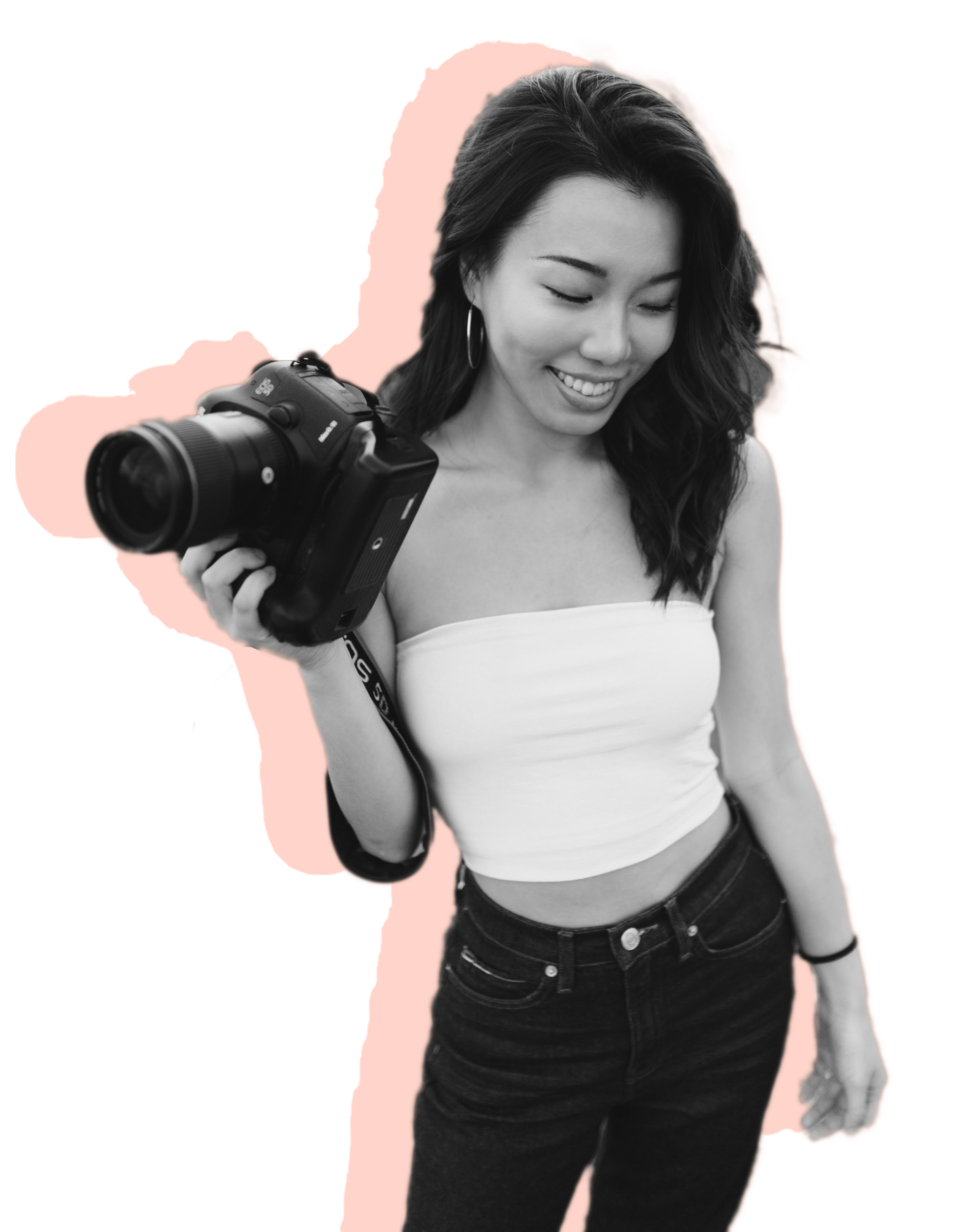 Ann holding a camera