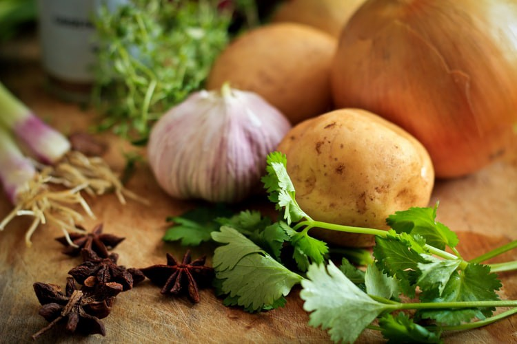 Table with parsley, onion, and potato