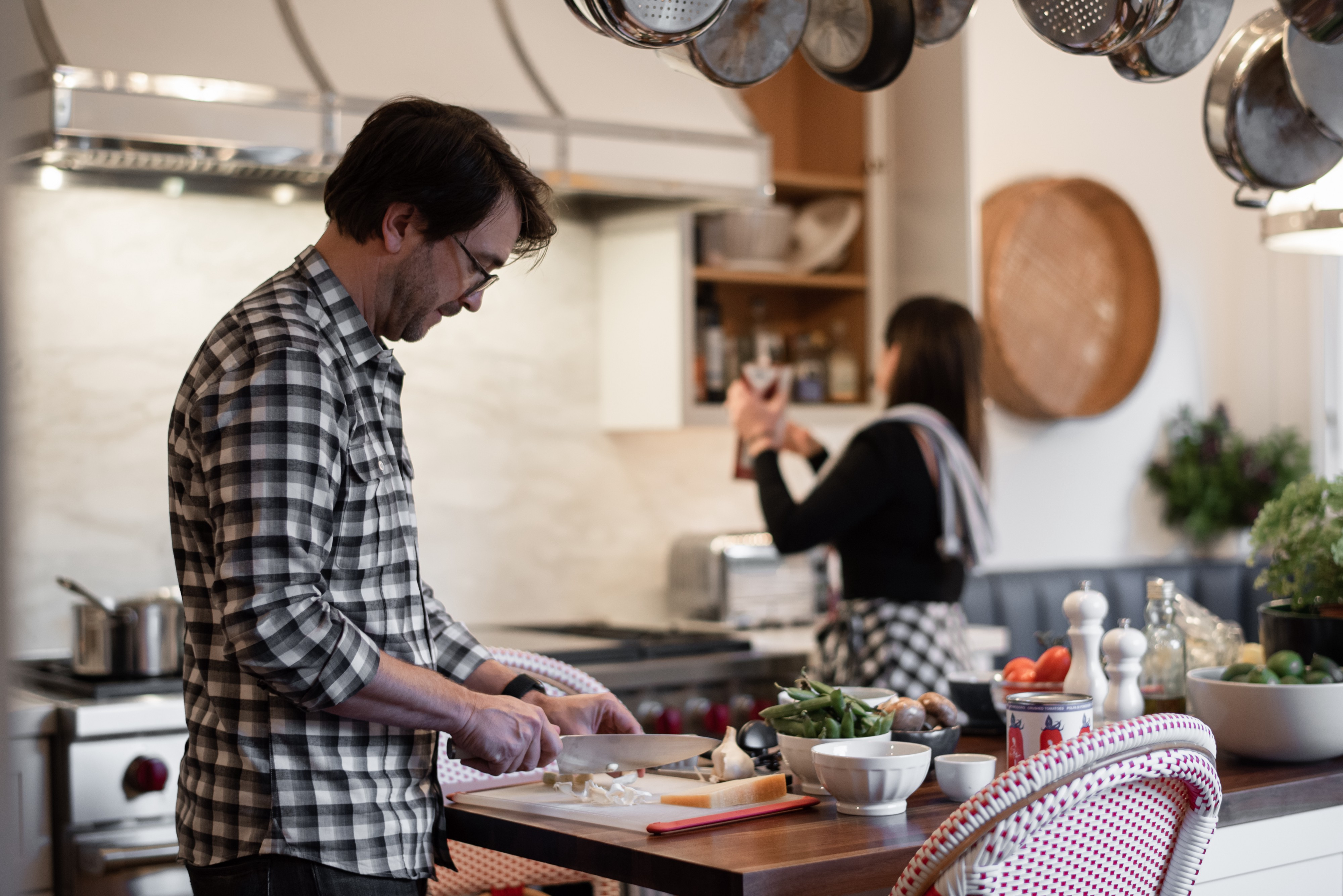Meal Hero team member chops garlic in a kitchen