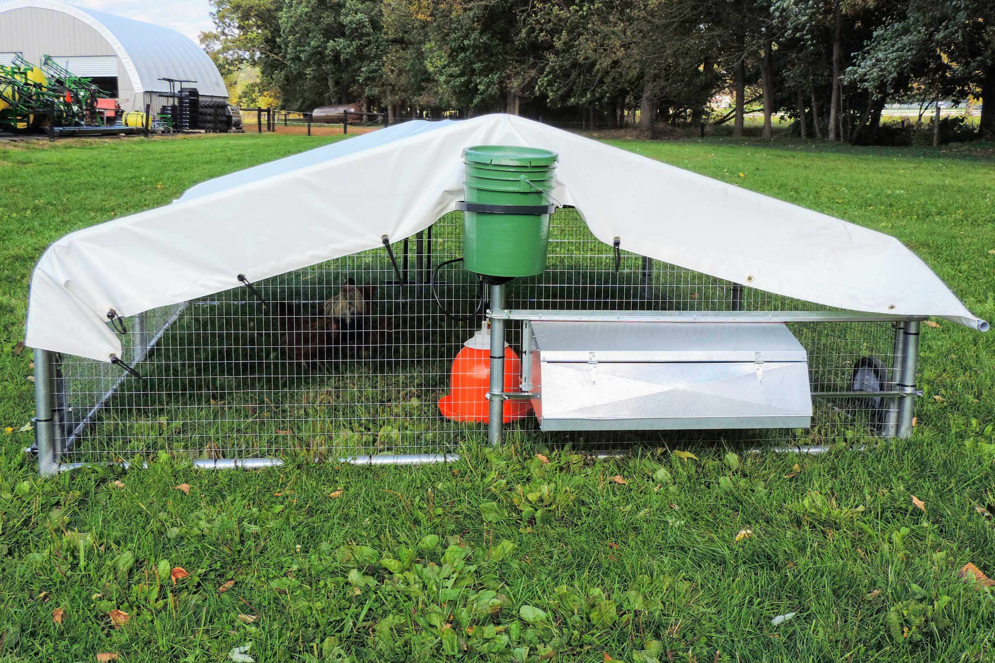 Chicken coop with water system and egg box