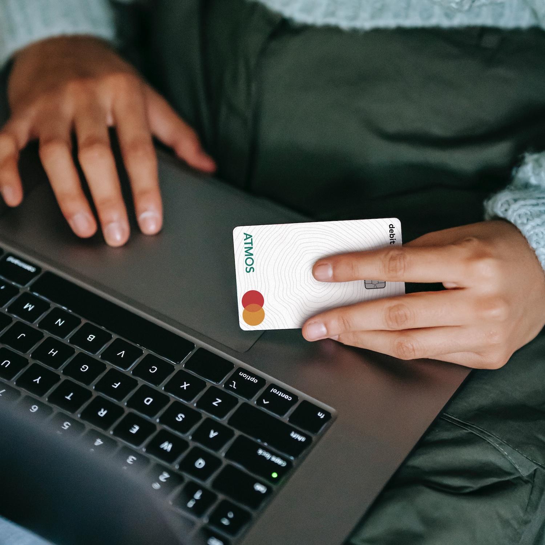 person shopping using atmos debit card