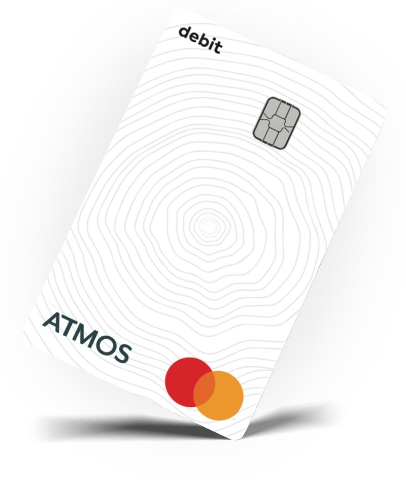 Atmos debit card, white with tree ring pattern, tilted to the right