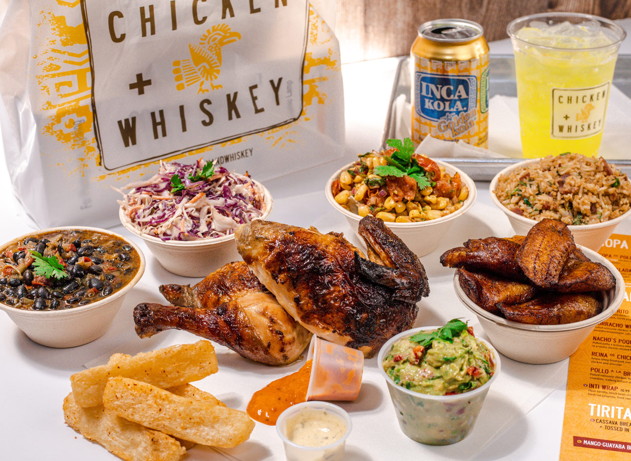 a full spread of chicken and whiskey food