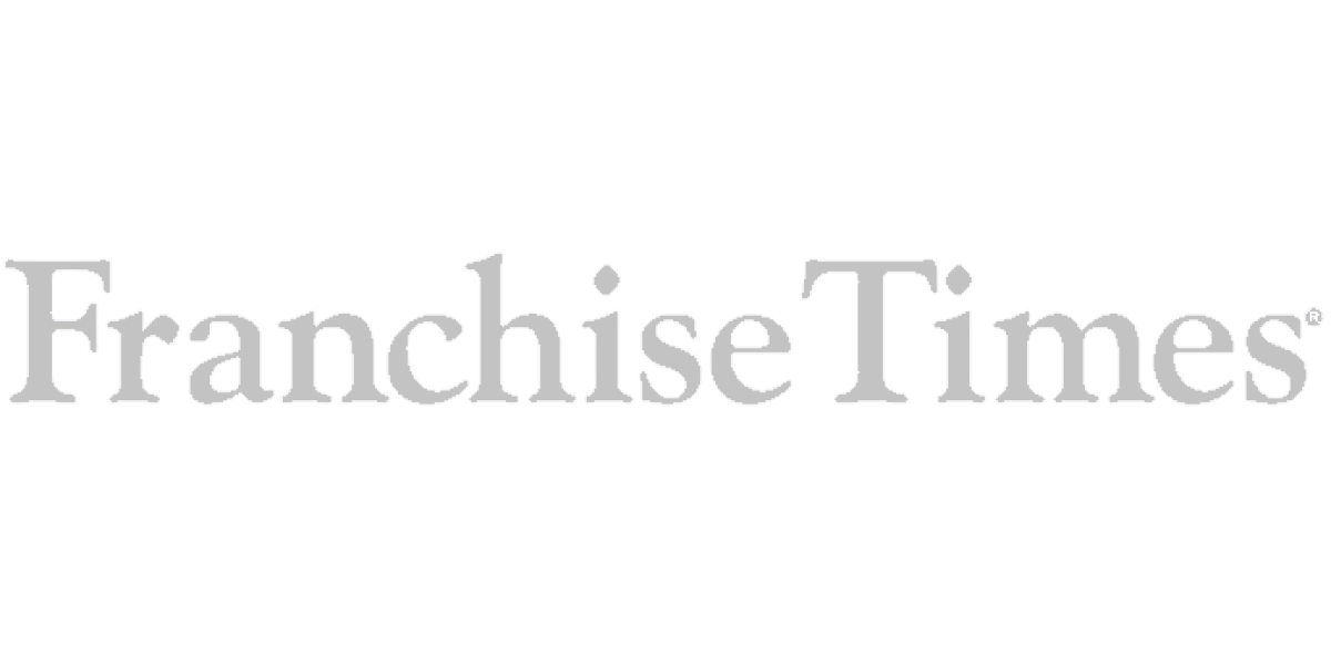 The logo for the news hub, the Franchise Times, in greyscale