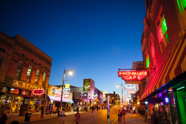 Beale Street in downtown Memphis, TN at dusk.