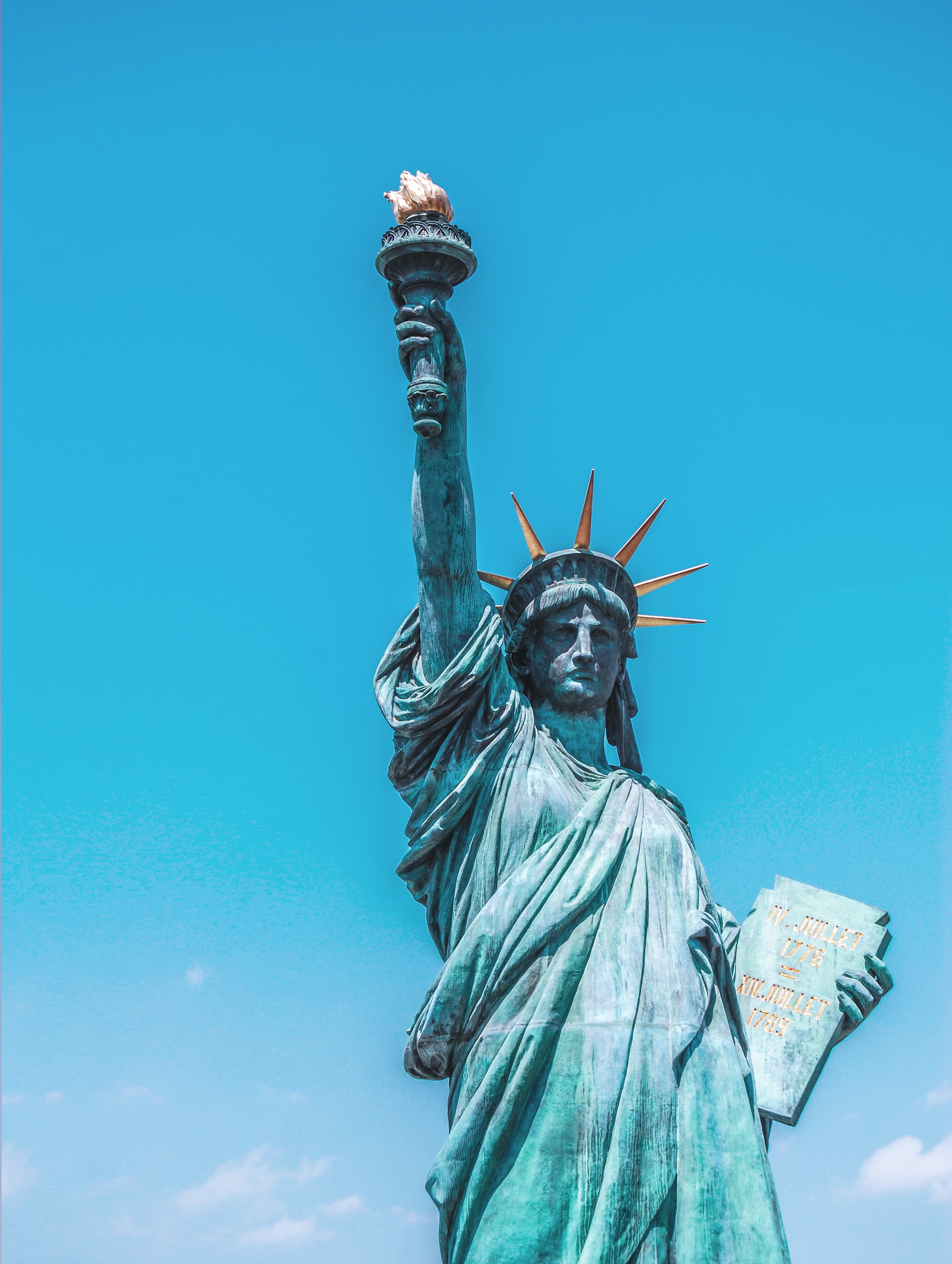The Statue of Liberty with a bright blue sky