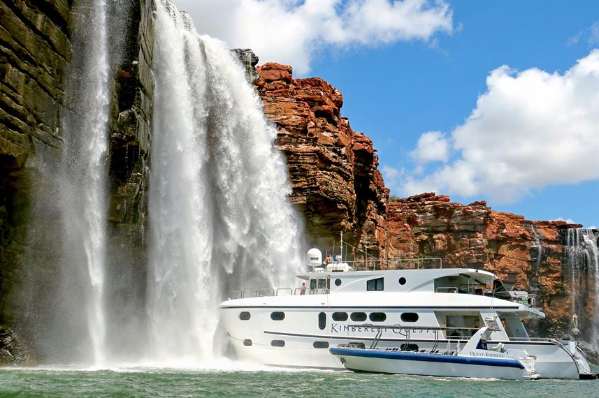 The Kimberley Quest cruise in front of a waterfall in the Kimberleys - Western Australia