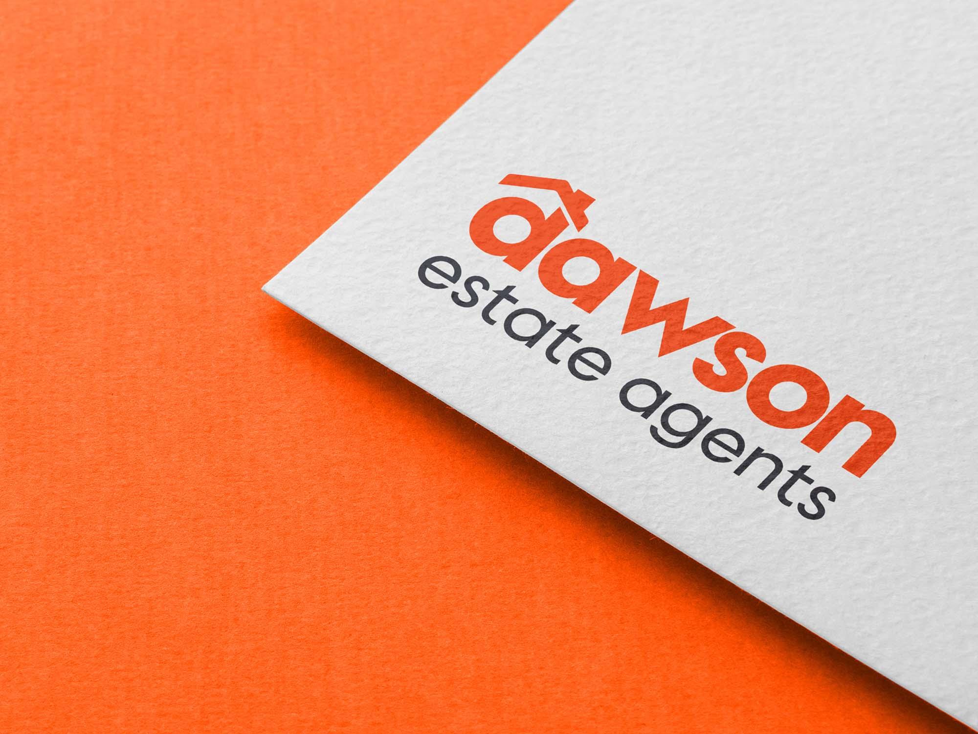 Dawson Estate Agents logo on parchment
