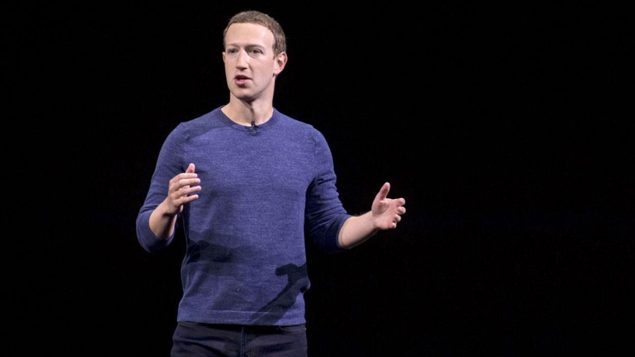 Mark Zuckerberg, founder of Facebook giving a speech on black background.