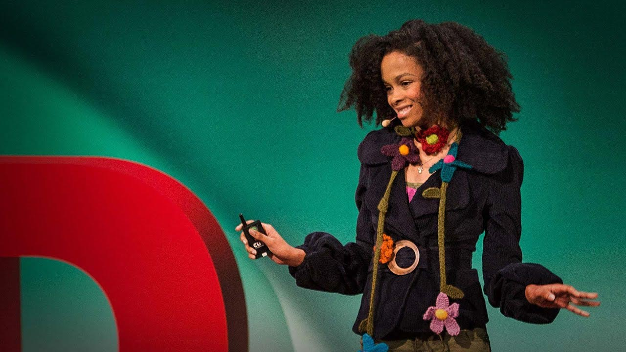 Maya Penn, founder of Maya's ideas giving a ted talk while wearing her products.