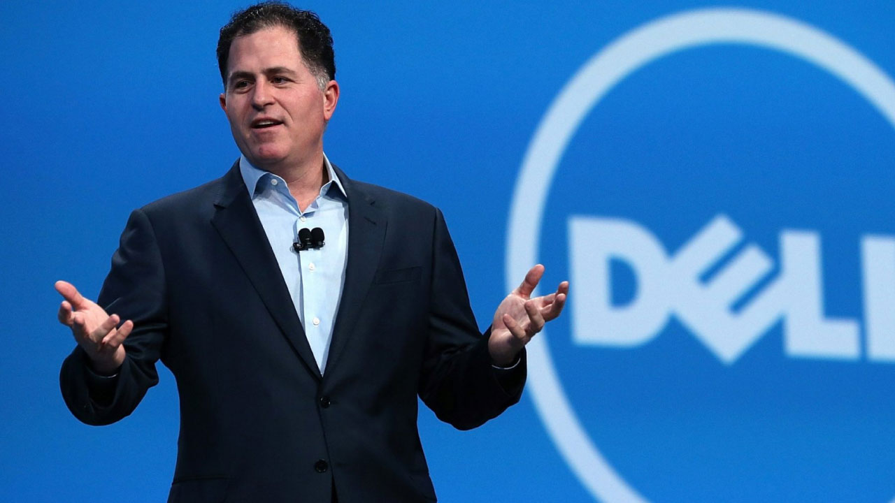 Michael Dell, founder of Dell giving a speech with Dell logo in the background.