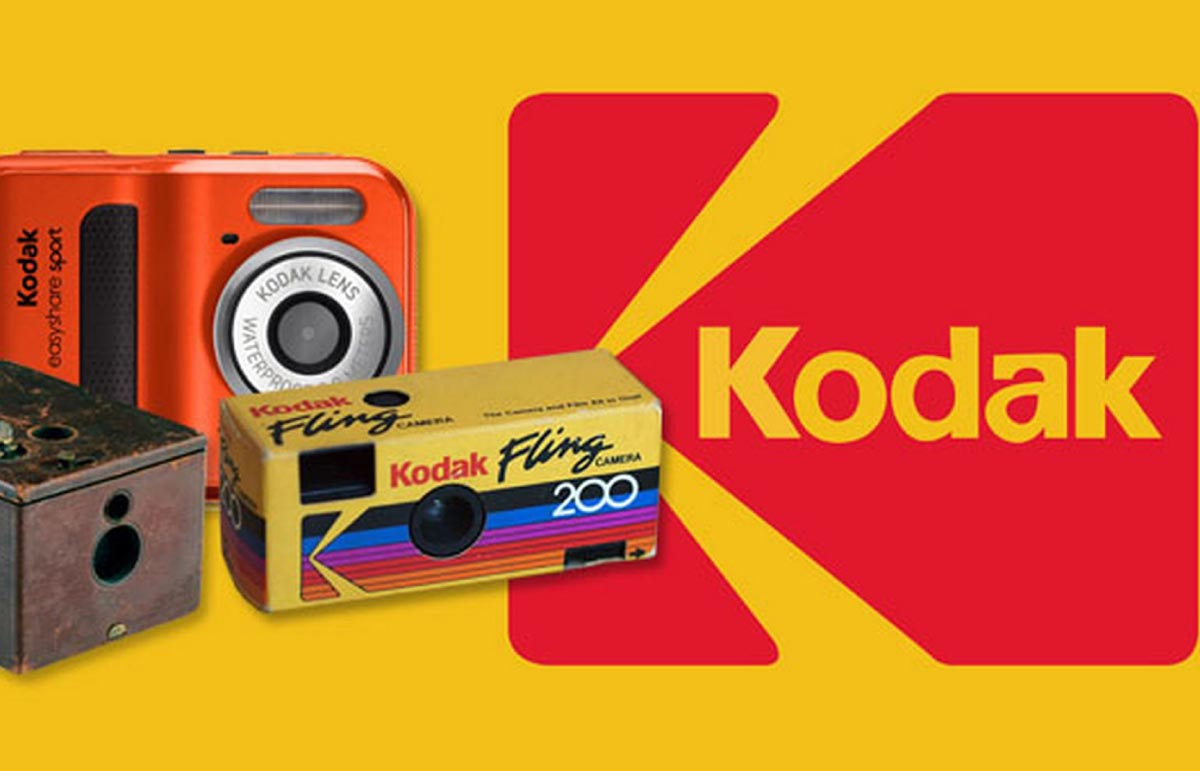 Kodak cameras and logo on yellow background.