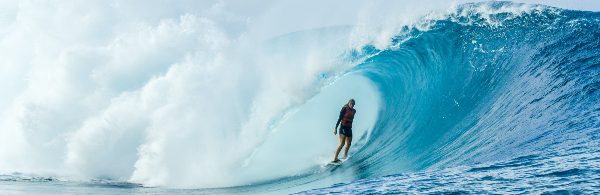 Bethany Hamilton surfing a perfect barrel wave at Teahupoo
