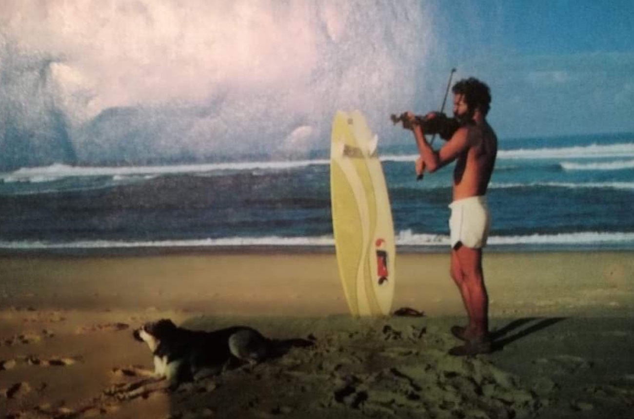 Randolph Benzaquen living the ultimate surfer's dream: violin, dog and surfboard