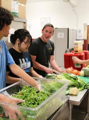 Help prepare meals for the community