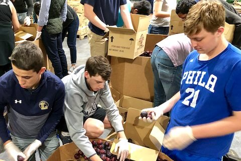 Students from La Salle College HS helping packing food at San Francisco Marin Food Bank