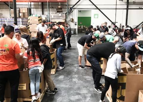 Volunteers helping to sort food at the San Francisco-Marin food bank